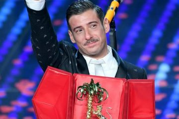 Italian singer Francesco Gabbani poses with the award on stage after winning the 67th Festival of the Italian Song of Sanremo, during the closing ceremony in Sanremo, Italy, 12 February 2017.   ANSA/CLAUDIO ONORATI
